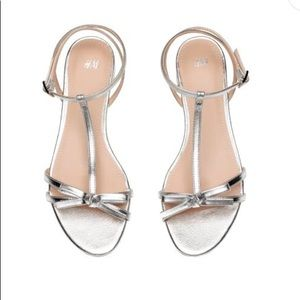 Silver sandals with bows